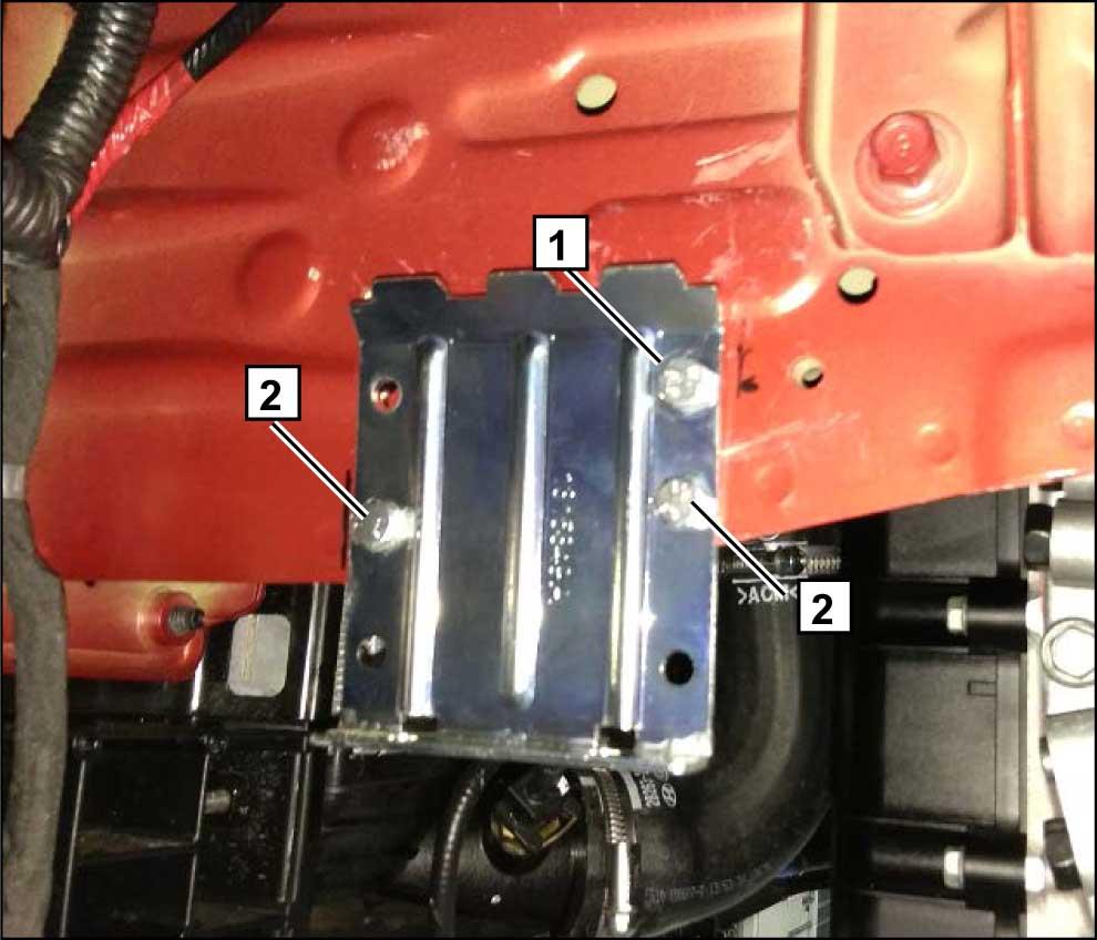 В ранее просверленное отверстие установить закладную гайку и зафиксировать часть составного кранштейна на кузове автомобиля болтом М6х20 1. Разметить и просверлить два отверстия в кузове автомобиля Ø 6,5 мм, закрепить часть составного кронштейна болтами М6х20 2.