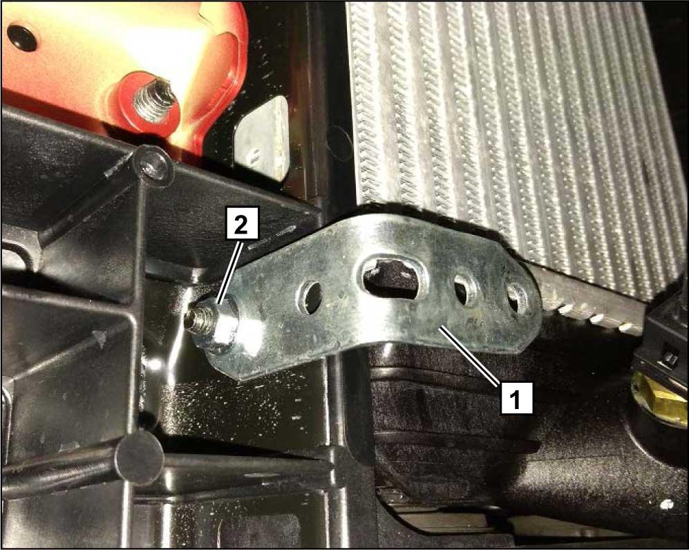 Подготовить кронштейн в соответствии с рисунком. Установить подготовленный кронштейн 1, используя штатную шпильку на кузове а/м 2.