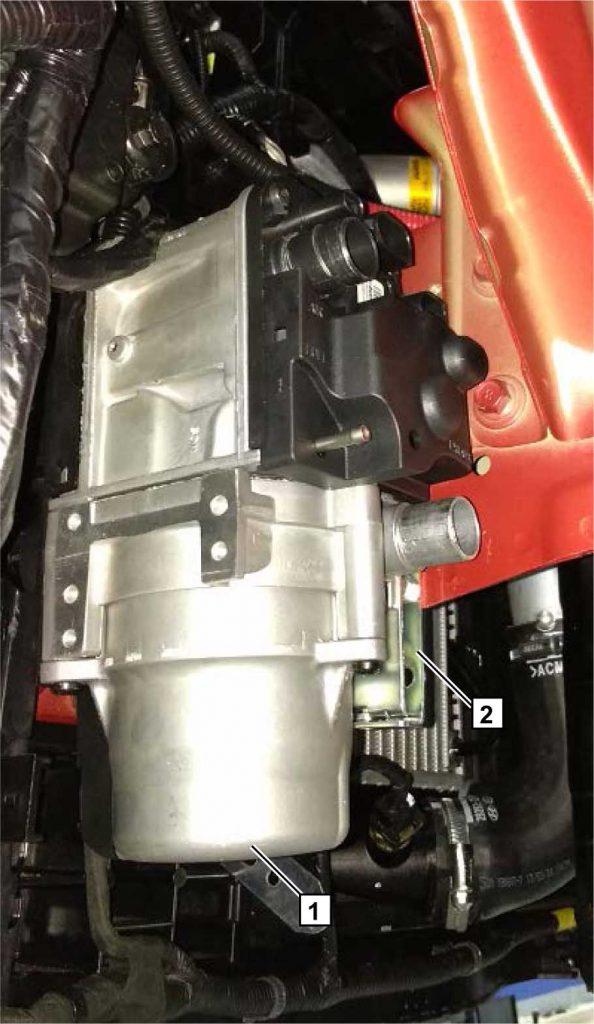 Установить подогреватель 1 на кузов автомобиля, совместив и зафиксировав части составного кронштейна 2.