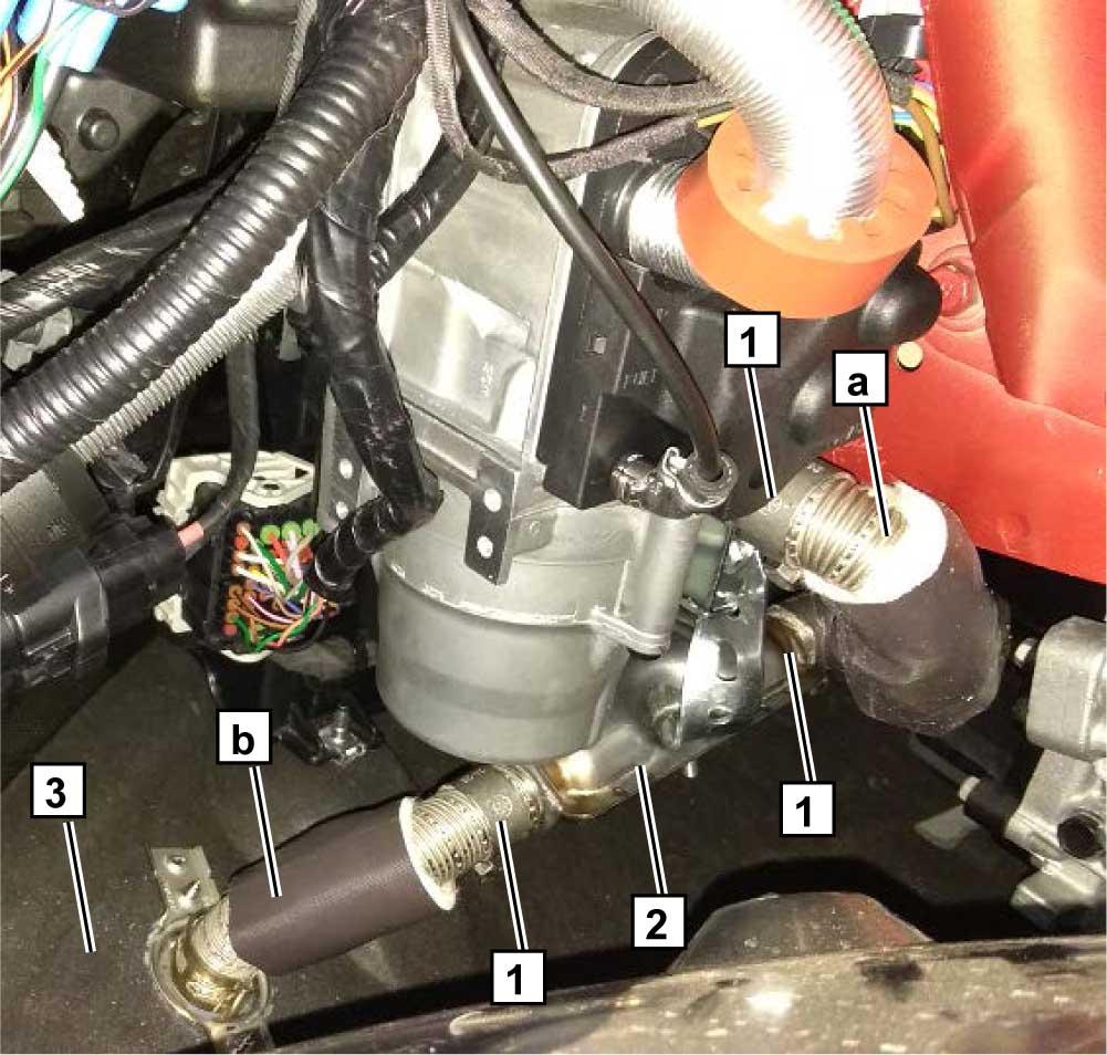 Закрепить часть выхлопной трубки a на подогревателе и глушителе 2 силовыми хомутами 1